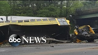 Download 2 killed, several injured after school bus collides with dump truck Video