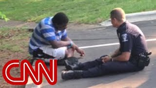 Download Photo of police officer consoling teen goes viral Video