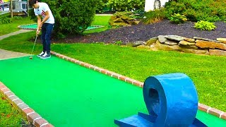 Download INSANE DOUBLE HOLE IN ONE! MINI GOLF: LETS PLAY FOR REAL! Video