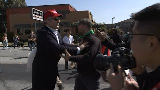 Download RAW VIDEO: Donald Trump supporter walks through angry crowd of protesters Video