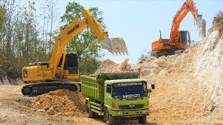 Download Excavator Dump Truck Digging Limestone On Road Construction Kobelco SK200 Komatsu PC200 Video