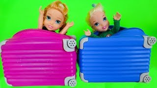 Download Elsa and Anna toddlers buy suitcases to go on holidays Video