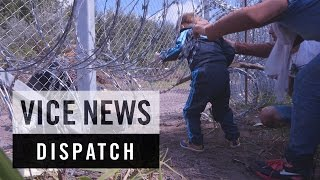 Download Cutting Through Hungary's Razor Wire Fence: Breaking Borders Video