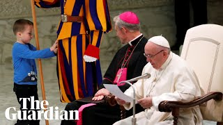 Download Pope Francis chuckles as boy climbs on stage and interrupts speech Video