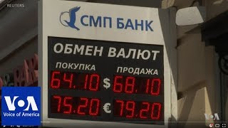 Download Russian Currency Plummets Following New US Sanctions Video