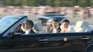 Download New Japanese emperor treats crowds to rare open-top car imperial parade   AFP Video