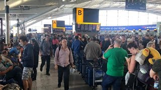 Download Stranded British Airways passengers slowly make way home after computer outage Video