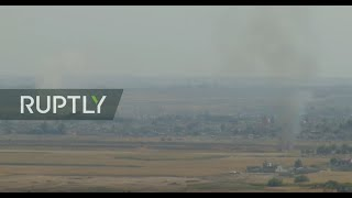 Download LIVE: Turkish-Syrian border: live images from Ras al-Ayn as Turkish military offensive continues Video