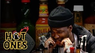 Download Curren$y Talks Munchies, Industry Games, and Rap Dogs While Eating Spicy Wings | Hot Ones Video