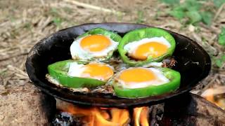 Download Survival skills: Chicken eggs in peppers grilled on clay for food - Cooking eggs eating delicious Video