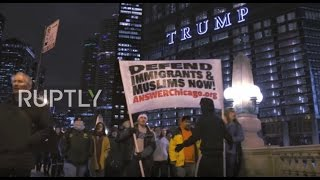 Download USA: Anti-Trump protesters march outside Trump Tower, Chicago Video