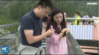 Download Terrified tourists dragged across record-breaking glass bridge in Chongqing, China Video