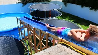 Download GIANT Backyard Water Slide in our Trampoline Water Park!! Video