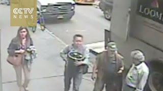 Download Footage: New York thief grabs pot of gold from armored truck Video