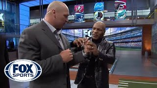 Download Mike Tyson gives Brian Urlacher boxing lessons Video