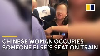 Download Furious argument after Chinese woman occupies someone else's train seat Video