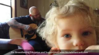 Download We've been breastfeeding for 2 years: Toddler loves to listen to Daddy play the guitar while nursing Video