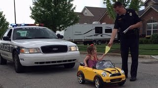 Download Cop Pulls Over 2-Year-Old Girl For Picking Her Nose Old While Driving Toy Car Video