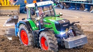 Download Incredible RC tractor at work on a field! Stunning detailed farming machine! Video