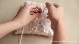 Download attaching wedding ring to your ring pillow Video