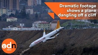 Download Dramatic footage shows a plane dangling off a cliff Video