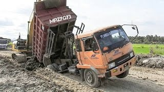 Download Dump Truck Stuck Recovery By Excavator And Dozer Video