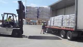 Download Loading double pallets of product onto a truck Video