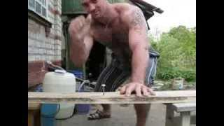 Download Russian man hammers nails with hand Video
