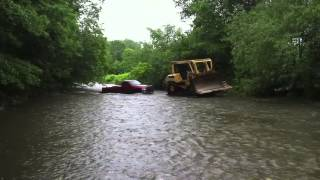 Download Cat D7 dozer rescues Dodge stuck in rising river Video