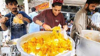 Download Street Food in Karachi - GOLDEN Chicken Biryani + HALEEM - Pakistani Street Food Tour of Karachi! Video