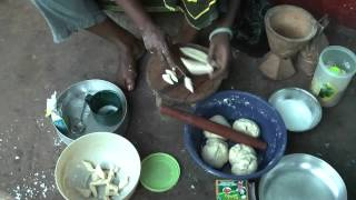 Download African Cooking - Tanzanian woman prepares traditional meals Video
