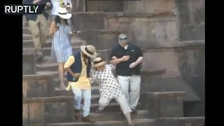 Download Hillary Clinton slips twice on stone steps during India visit Video