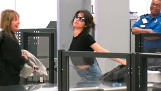 Download Camila Cabello Turns LAX TSA Into A Runway, Striking Poses For The Paparazzi! Video
