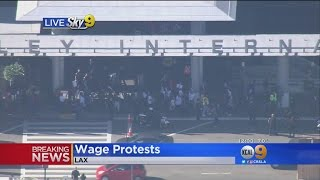 Download Workers March On LAX For $15 Minimum Wage Video