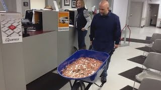 Download Man Pays Nearly $3,000 Bill Using A Wheelbarrow Full Of Pennies Video