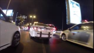 Download Riding through traffic in Jeddah. Lots of nice cars! Video