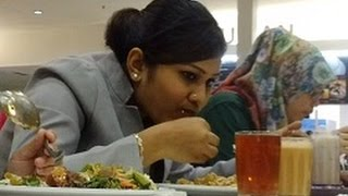 Download Indian Lady eating with her hands, Its a cultural thing. Video