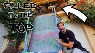 Download TRAMPOLINE FILLED WITH STYROFOAM PEANUTS (COMPLETELY FULL) Video