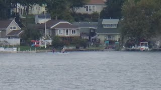 Download People Paddle Boating While Kneeling Video