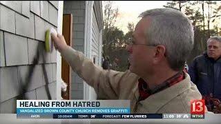 Download Parishoners clean graffiti off of Brown County church Video