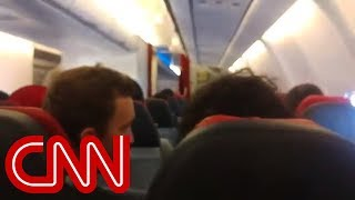 Download Pilot of shaking plane asks passengers to pray Video