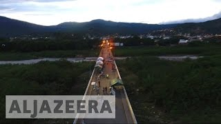 Download Venezuela: Thousands cross bridge into Colombia for better opportunities Video