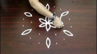 Download flower muggulu with 7 to 4 interlaced dots-simple flower kolam-simple rangoli flower design Video