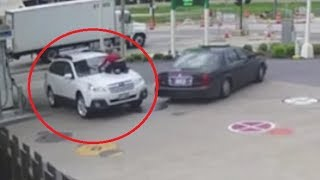 Download Milwaukee woman jumps onto the hood of her SUV to stop carjackers Video