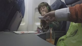 Download Hidden Camera Shows How Strangers Can Get Close To Unaccompanied Minors on Planes Video