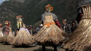 Download Men dance in grass skirts, captured in slow motion Video