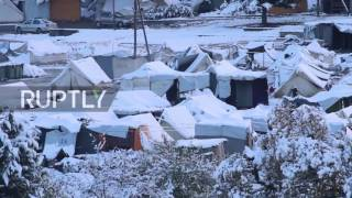 Download Greece: Refugees living in freezing conditions after heavy snowfall in Katerini Video