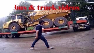 Download TRUCK TRAILER FUSO MUATAN MOBIL TAMBANG SLIP DI SITINJAU LAUIK KARENA HUJAN Video
