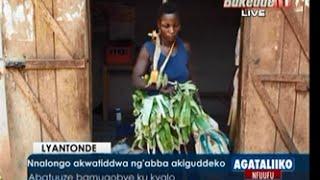 Download Nnalongo akwatiddwa ng'abba akiguddeko Video
