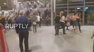 Download UK: Crowd flees after fatal 'explosion' at the Manchester Arena Video